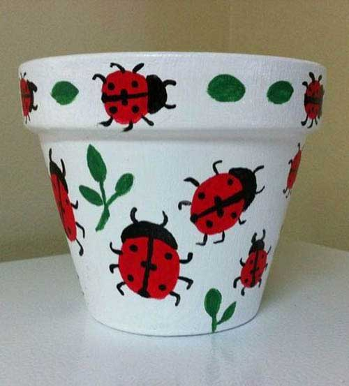 Painted Clay Pot Ladybugs On White Background
