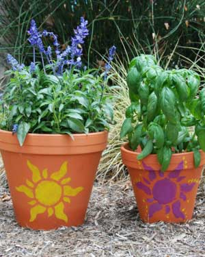 Sun Stencils on Terracotta Pots